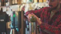 Bartender squeezing lime juice. Agility. Art bartender Stock Footage