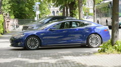 New blue Tesla car in city Stock Footage