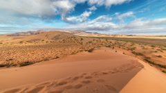 Beautiful clouds over sand dune in the national park Altyn Emel. 4K TimeLapse - Stock Footage