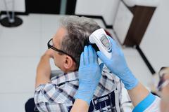 Diagnostics hair and scalp. Trihoskopiya Stock Photos