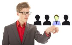 Young business man selecting virtual friends isolated on white background Stock Photos