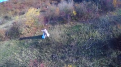 Newlyweds dance in the field aerial view Stock Footage