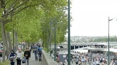 People walking on Quai d'Orsay boulevard riverside Seine Stock Footage