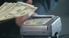4K Cashier Refusing Cash and Pointing The Credit Card Terminal For Payement Stock Footage