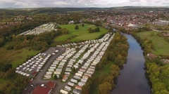 Aerial view of a caravan park beside a river. Stock Footage