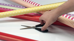 Take scissors from the table with wrapping paper Stock Footage