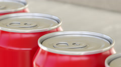 Soft drink or beer production line. Red aluminum cans on industrial conveyor Stock Footage