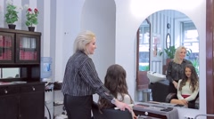Stylist demonstrates her work - makeup and hairstyle smiling beautiful model Stock Footage