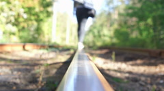 Woman with luggage walking down railroad track, leaving place. Wanderer, tourist Stock Footage