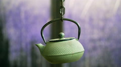 Japanese tea pot swinging on chains over a table in a Japanese house. Looped Stock Footage