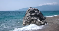 View of Waves Rolled at Sea Coast Line With Huge Rock Stock Footage