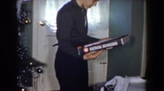 1960: boy opens electrical engineering gift at christmas BEL AIR MARYLAND Stock Footage