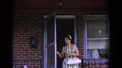 1960: a woman steps out the door of a house BEL AIR MARYLAND Stock Footage