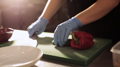 Chef cutting cucumber in commercial kitchen. Stock Footage