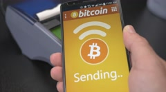 4K Mobile Phone Paying With Bitcoins at Store Stock Footage