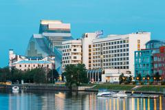 Riga Latvia. Evening Cityscape At Bank Of Daugava River With National Library Stock Photos