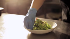 Hands of chef put sliced boiled eggs and tomatoes. Spinach and lettuce leaves. Stock Footage