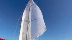 Proper configuration of the spinnaker on a fair wind Stock Footage