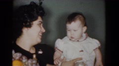 1960: adults holding the baby. BEL AIR MARYLAND Stock Footage