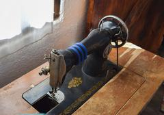 The old manual sewing machine. The machine for stitching thread wear Stock Photos
