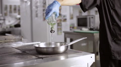 Chef add olive oil into heat pan for cooking Stock Footage