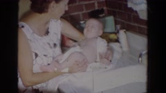 1965: mom pacifying little baby who is restless after a nap FALLSTON MARYLAND Stock Footage