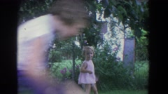 1965: childrens playing younger sister and her elder sister both are playing Stock Footage