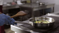 A stir fry meal being prepared in a hotel or restaurant kitchen Stock Footage