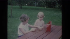 1965: happy girls playing in the back yard. FALLSTON MARYLAND Stock Footage