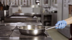 Chef throwing vegetables in the air with a frying pan. Stock Footage