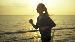 Young woman preferring healthy mode of living, running near the sea Stock Footage