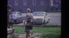 1965: girl crying as she visits the neighbors. FALLSTON MARYLAND Stock Footage
