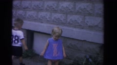 1965: children playing in the backyard of a house FALLSTON MARYLAND Stock Footage