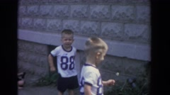 1965: children playing in open area with grass around FALLSTON MARYLAND Stock Footage