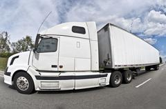 Big Tractor-Trailer Rig On Interstate Highway Stock Photos