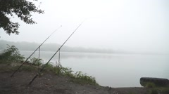 Fishing rod on the river in a foggy morning Stock Footage