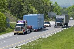 Oversized Load In Traffic On Interstate Highway Stock Photos