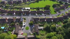Aerial view of a housing estate in bright sunshine. Stock Footage