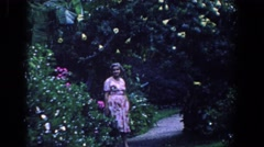 1958: a very nice lady talking about the beautiful horticulture  Stock Footage