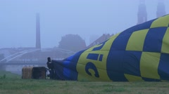 Preparation For Flight on a Hot Air Balloon. Foggy Day. Against the Backdrop of Stock Footage