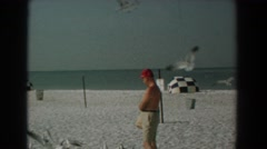 1958: a man feeding seagulls at the beach YORKTOWN VIRGINIA Stock Footage