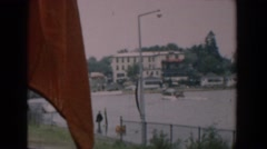 1958: a watercraft enters a harbor at high tide in the summer on a windy day Stock Footage