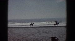 1958: friends riding horseback along the ocean shore. YORKTOWN VIRGINIA Stock Footage