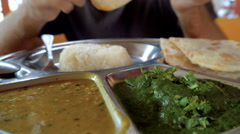 Caucasian man eat indian food Stock Footage
