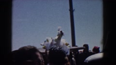 1958: a man is moving through the crowd with a magnificent cap YORKTOWN VIRGINIA Stock Footage