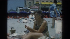1958: women sitting out in the sand. YORKTOWN VIRGINIA Stock Footage