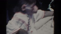 1958: family footage of a beach trip featuring a brief appearance by a monkey. Stock Footage