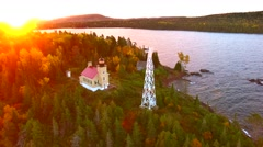 Scenic Copper Harbor Michigan lighthouse with Autumn colors, at dawn Stock Footage
