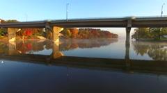 Scenic drone flight under bridge with Autumn colors Stock Footage