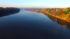 Scenic flight over foggy river with Autumn colors Stock Footage